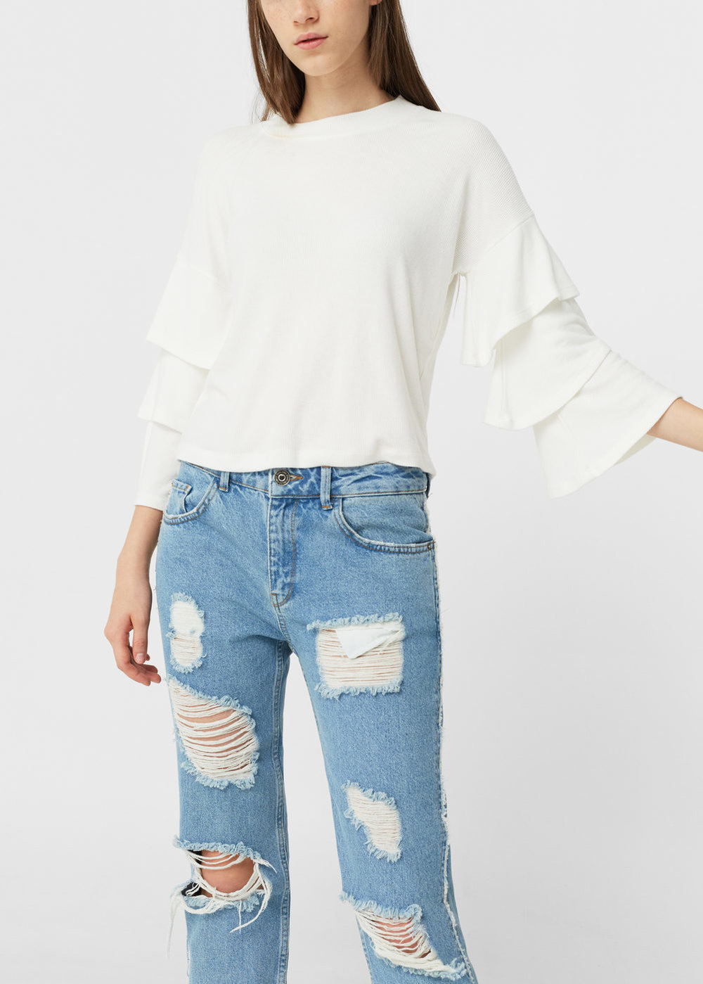 Back at it again with the ruffles! But really though,   this is a nice basic t-shirt   that's comfortable to wear a lot but with ruffle detail on the sleeves so that again, you're outfit is anything but boring.