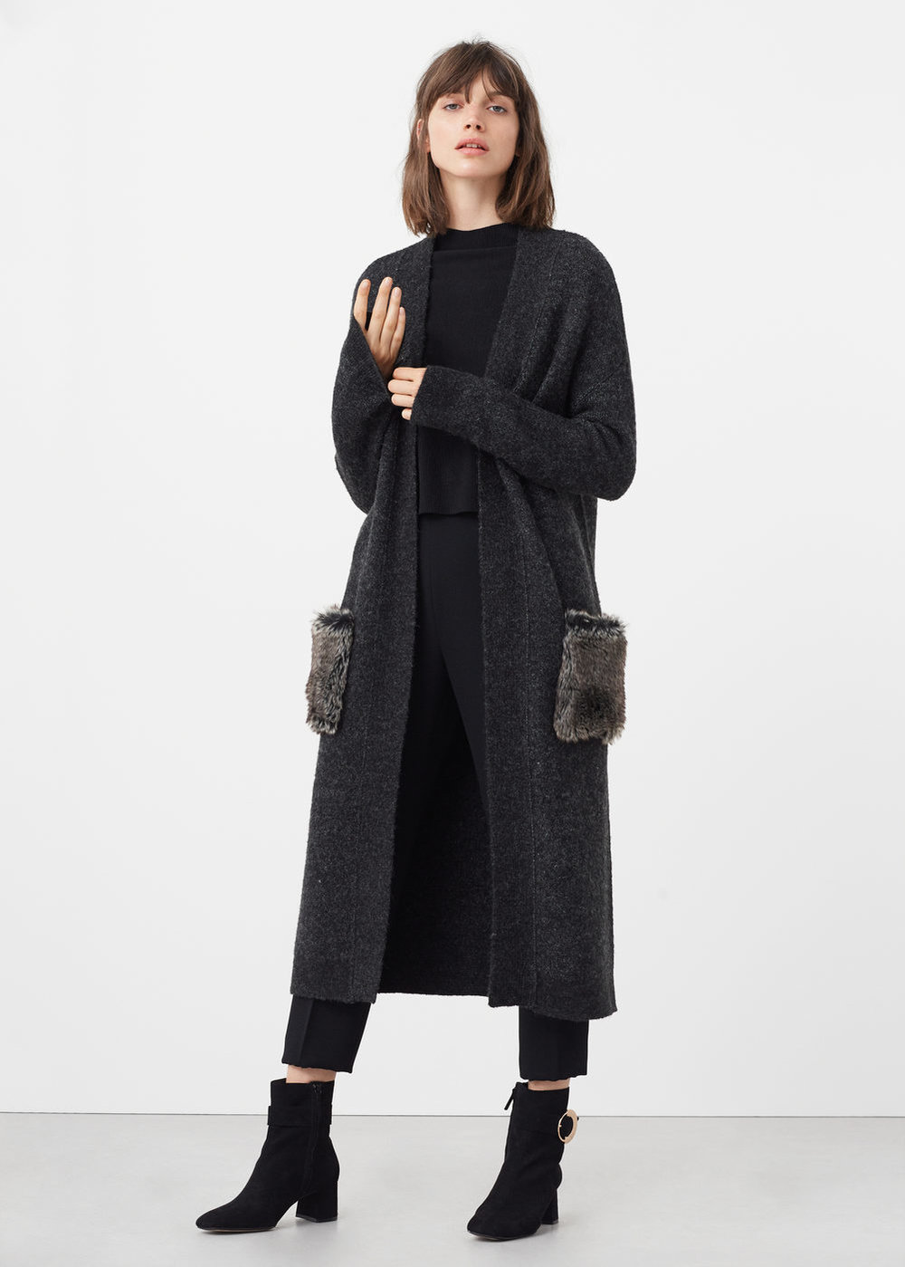 I love long cardigans like   this one  , and the faux fur pocket adds a nice touch.