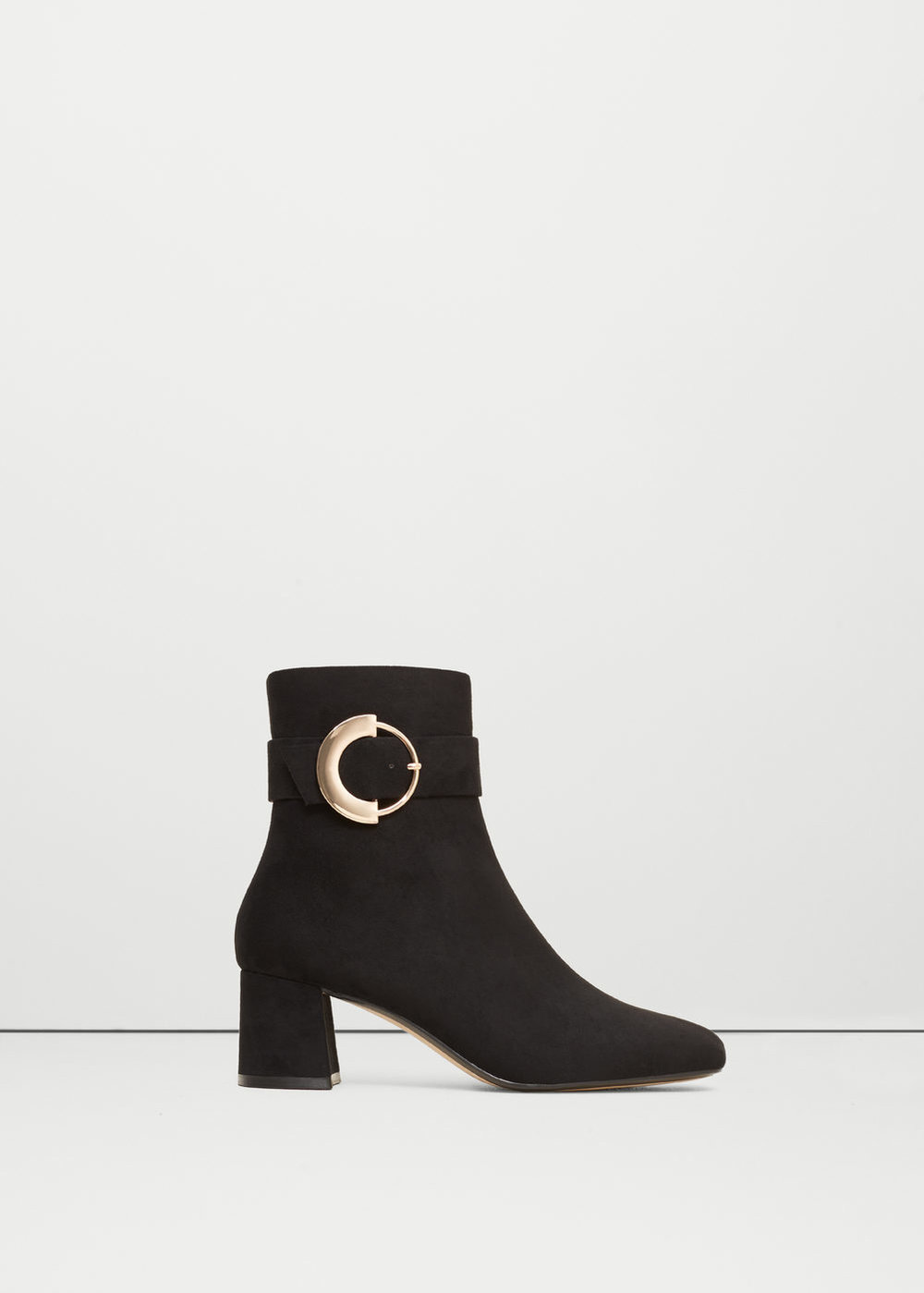 If you know me you know I love ankle boots, they're the only kind I wear these days because they're so cute on and   this buckle detail   is no different. Plus the heel isn't too high so they're wearable for everyday.