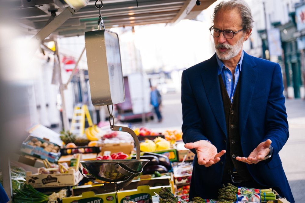 Anthony talking to a grocer in Notting Hill
