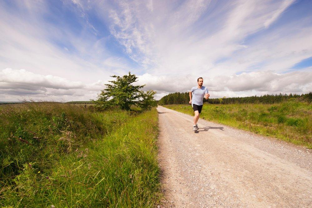 Man running through the countryside