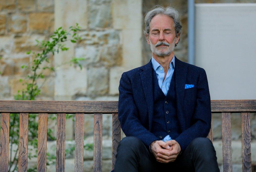 Anthony Thompson meditating on a bench