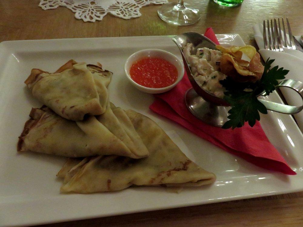 Pancakes with shrimp salad and salmon caviar