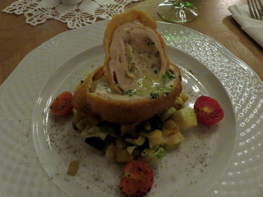 Chicken kiev with smoked cheese and warm zucchini