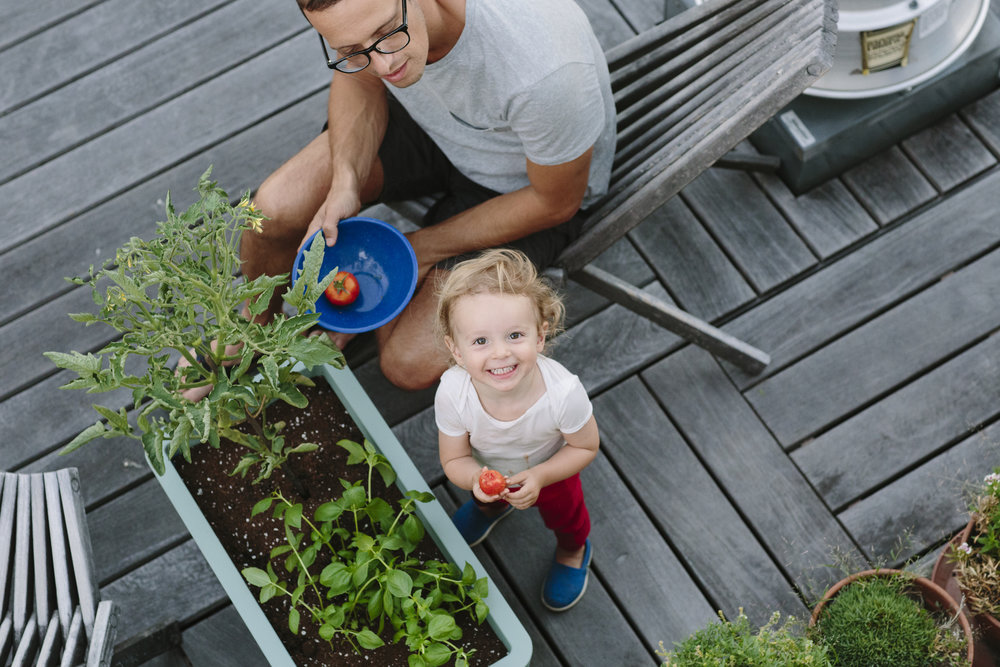 Idan and his daughter Ellie on their rooftop garden in the East Village.