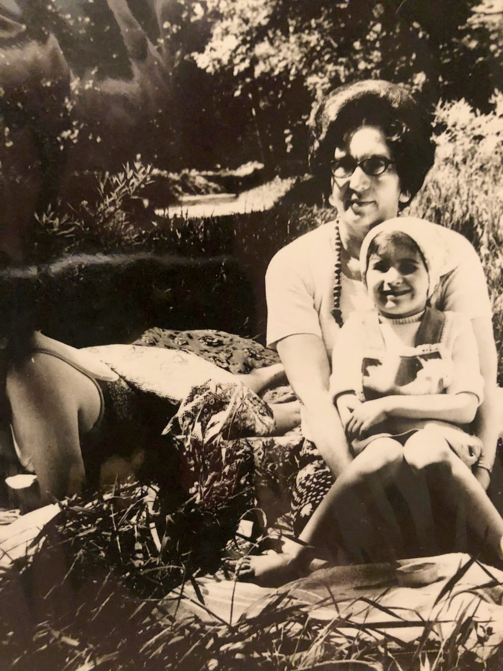Sasha around age 7 with her Grandmother at a dacha right before they came to America.
