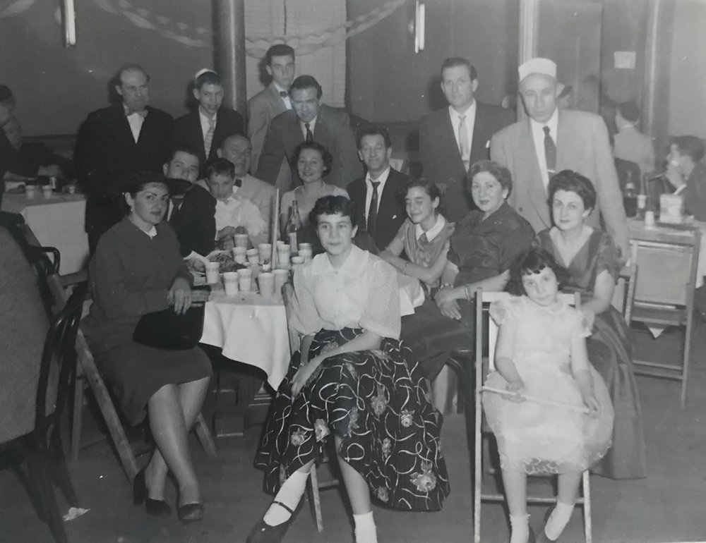 Family photo from cousin Arthur's Bar Mitzvah, Queens, 1956. Jane is seated (front row all the way to the right) with Bertie seated directly behind her.