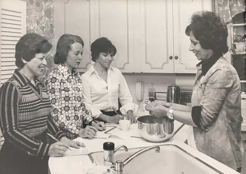 Etty, on the right, teaching a Persian cooking class to some area housewives in Providence, Rhode Island.