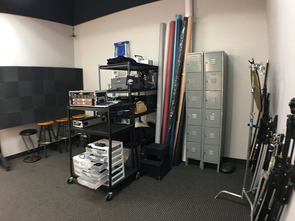 The gear room/make-up station is packed with equipment.