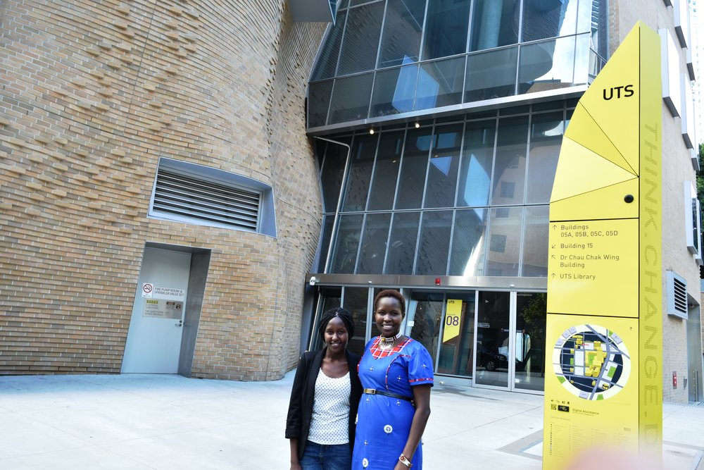 Sharon with Dr. Kakenya Ntaiya in front of UTS