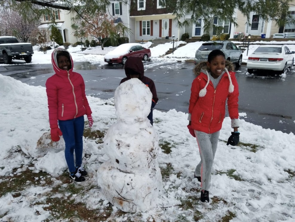 The girls build their first snowman!