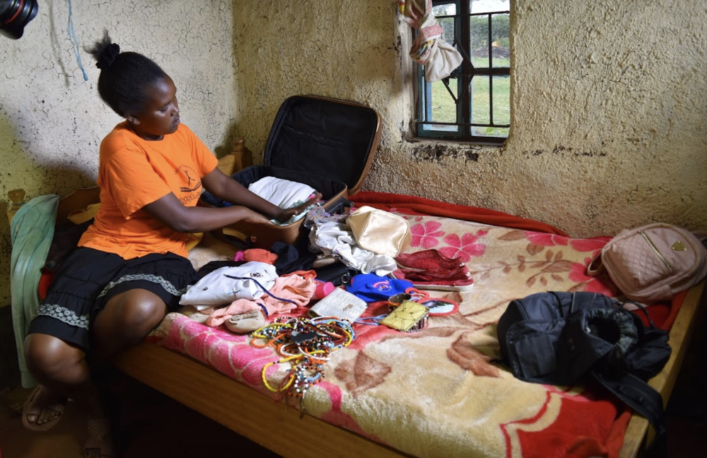 Linet packs at her family home ahead of the trip