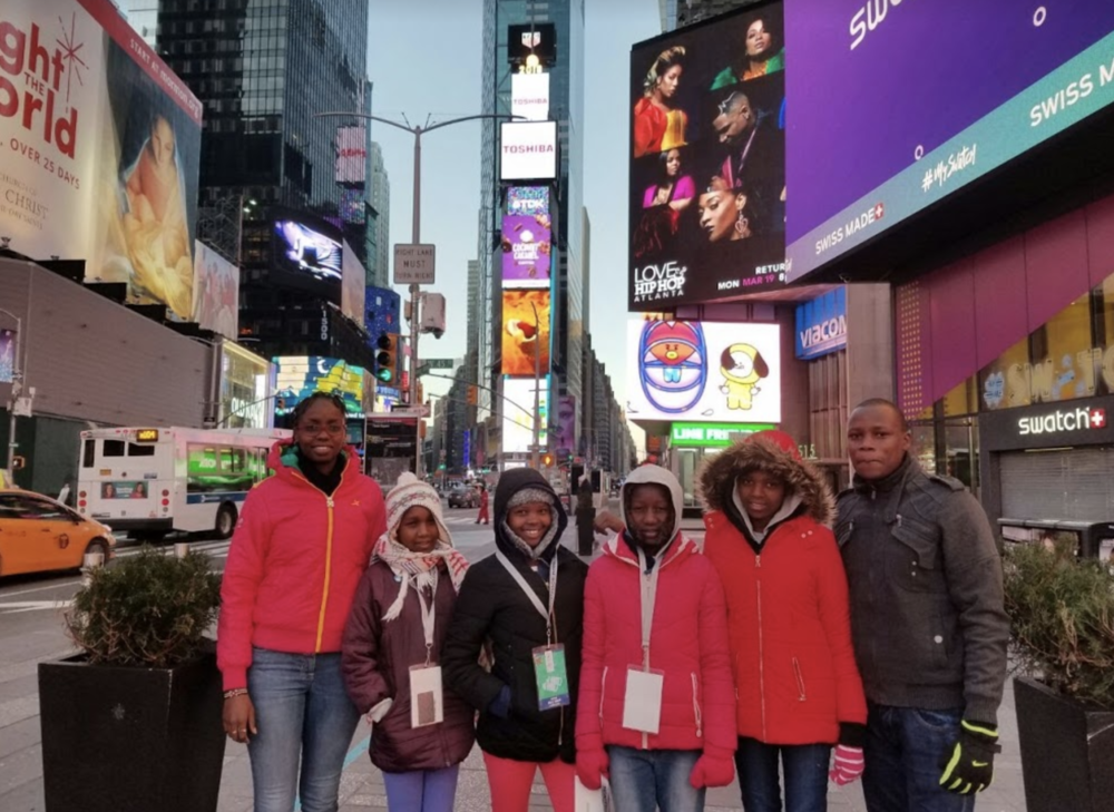 The visitors pause for a picture in NYC's Time Square