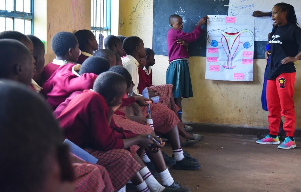 Girls learn about their bodies in a session on sexual and reproductive health.