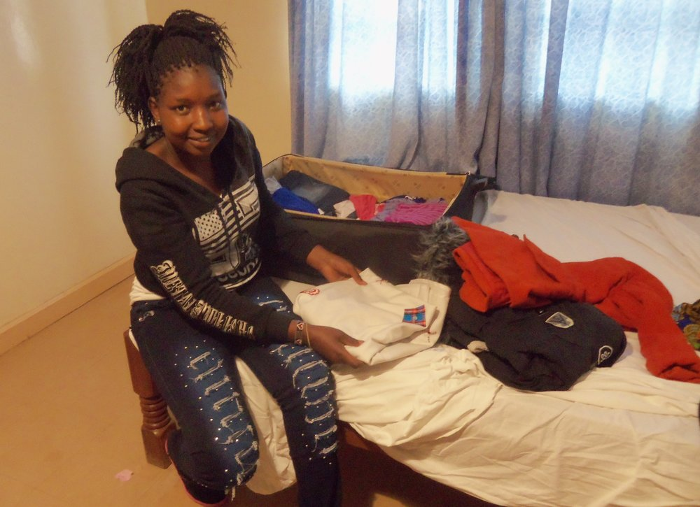 Magdalene packs for the trip to Australia.