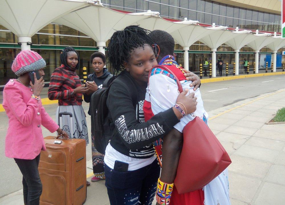 Magdalene hugs her mom before she says goodbye.