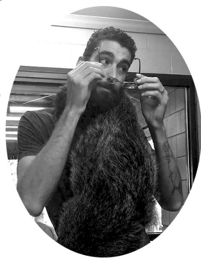 ...sorry about the picture, I don't take selfies, but that's a binturong hanging from my neck if you were curious. :D