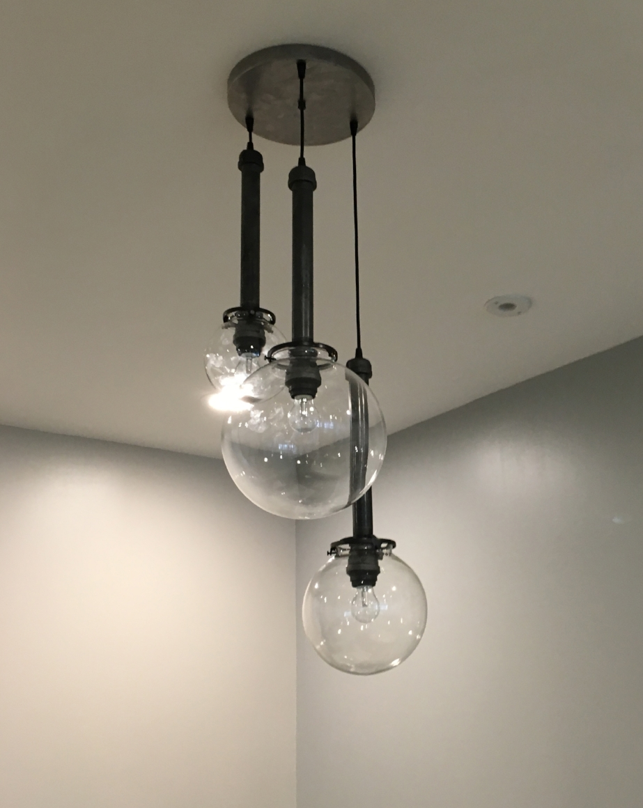 Glass Globe Chandelier | The Times Properties | Bay City, MI