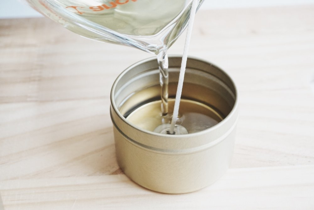 hand pouring all natural soy candle