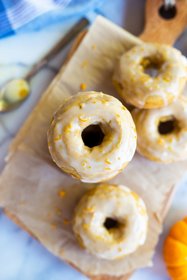 Gluten Free Pumpkin Orange Glazed Doughnuts {Dairy Free}  Prep time :20 mins  Cook time:25 mins  Total time:45 mins  Serves:12  INGREDIENTS:  2 cups gluten free 1:1 baking flour (I use Bob's Red Mill)  2 teaspoons baking powder  1 teaspoon salt  ½ teaspoon ground cloves  ½ teaspoon ground nutmeg  1¼ teaspoon ground cinnamon  ⅔ cup pumpkin puree  ⅔ cup plus 2 tablespoons light brown sugar  2 large eggs  ½ cup plain, unsweetened almond milk  4 tablespoons melted butter, cooled (I used non-dairy Earth Balance)  1 teaspoon orange juice  ½ teaspoon orange zest  Glaze:  2 cups confectioners sugar, sifted  3 tablespoons plain, unsweetened almond milk  1 tablespoon orange juice  1 teaspoon orange zest  Instructions:Pre-heat oven to 350 degrees Fahrenheit. Grease a doughnut pan and set aside. In a medium sized bowl, mix together flour, baking powder, salt and spices. In a large bowl, beat together the pumpkin brown sugar and eggs. Next add the almond milk, cooled melted butter, orange juice and orange zest and mix again until combined.  You can either spoon the batter into the doughnut pan or you can place the batter into a pastry bag fitted with a large tip and pipe the batter in. Make sure batter isn't overflowing. Bake doughnuts until a toothpick inserted comes out clean, about 12 minutes. Carefully remove doughnuts from the pan and let cool on a rack. Re-peat process with remaining batter. You should be able to get 12 doughnuts from this recipe.  Make the glaze: Add all glaze ingredients to a small bowl and whisk together until you have a smooth glaze with no lumps. Spoon desired amount of glaze over each doughnut and enjoy!