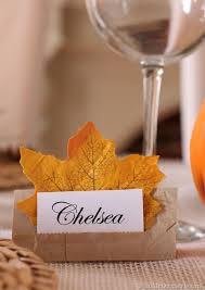 Place cards are always an easy way to make sure that Thanksgiving goes seamlessly and everyone has a place to sit, especially if the people coming to your party don't know each other well. Simply buy some construction paper and cut into small rectangles then fold those in half. Get some decorative leaves at your craft store and print out the names of your guests (cut the paper accordingly). Next, you can use the left over construction paper to cut out a small rectangle that will be placed on the bottom half of the place card. Glue the left and right sides down to the place card leaving an opening in the middle. Slide the leaf in and then place the printed name paper in there as well.