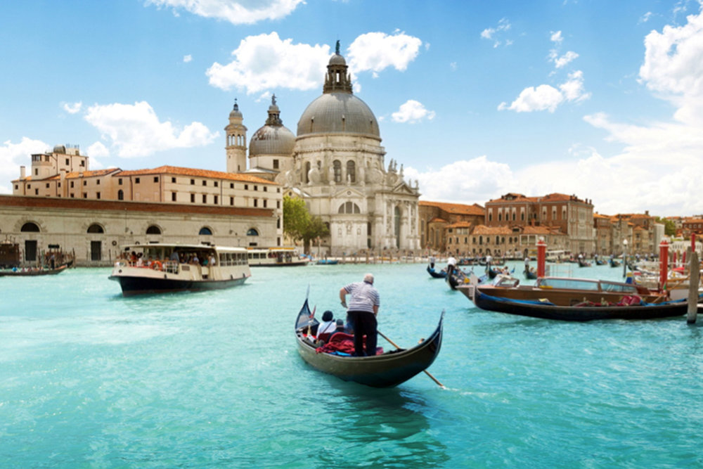 The capital of northern Italy's Veneto region, Venice is built on more than 100 small islands in a lagoon in the Adriatic Sea. Containing Byzantine mosaics, renaissance palaces, and the Grand Canal thoroughfare, Venice is a must see.