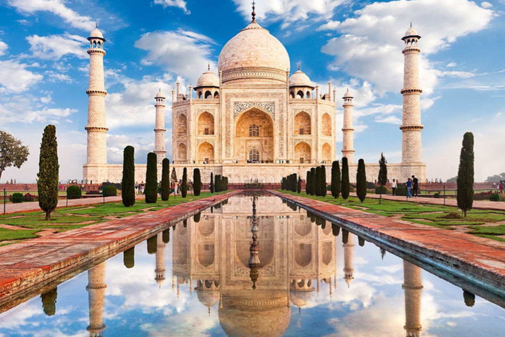 Derived from the name of Shah Jahan's wife, Mumtaz Mahal, the Taj Mahal is synonymous to love and romance. The name 'Taj Mahal' means 'Crown Palace', and the purity of this white marble monument makes it so inviting.