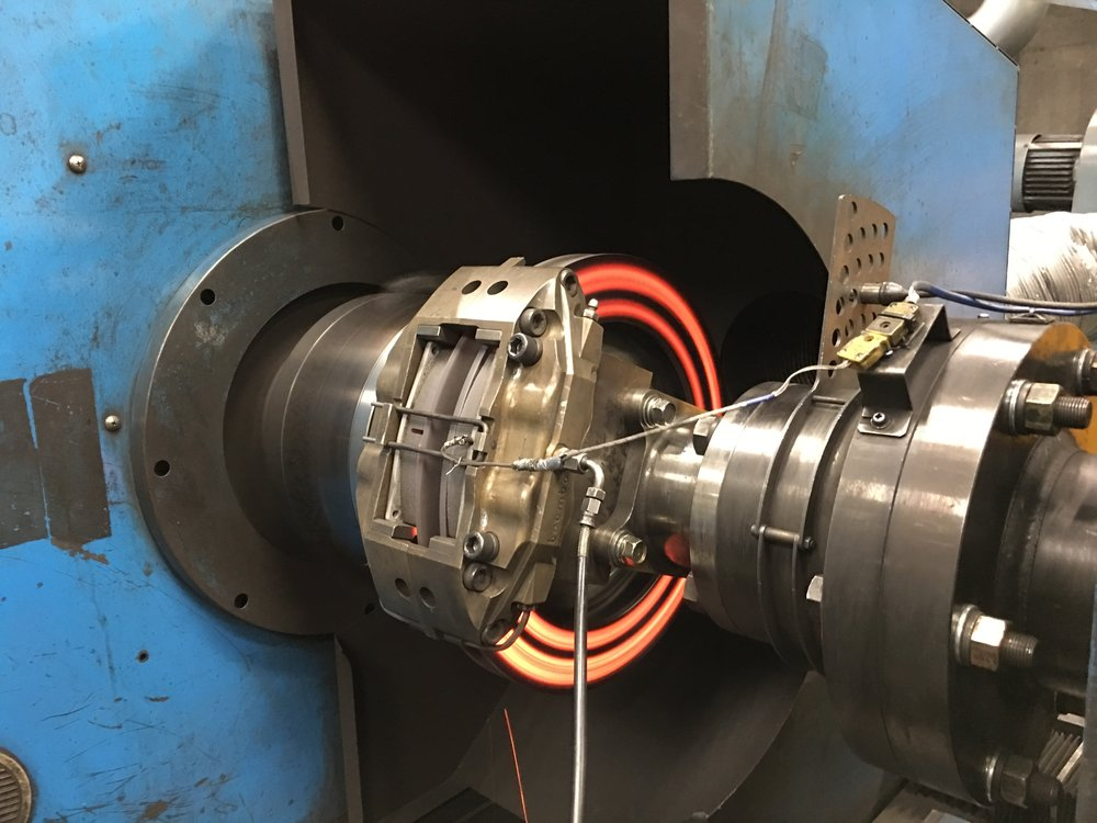 BRAKE COMPONENTS BEING RUN ON A BRAKE DYNAMOMETER.  PHOTO CREDIT: GANESH KRISHNAN