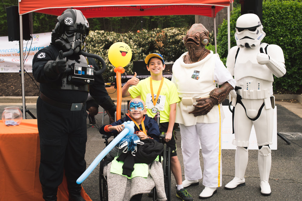 Members of the 501st Garrison Tyranus and our Honored Hopecam child Fletcher with our first place winner in the childrens division.