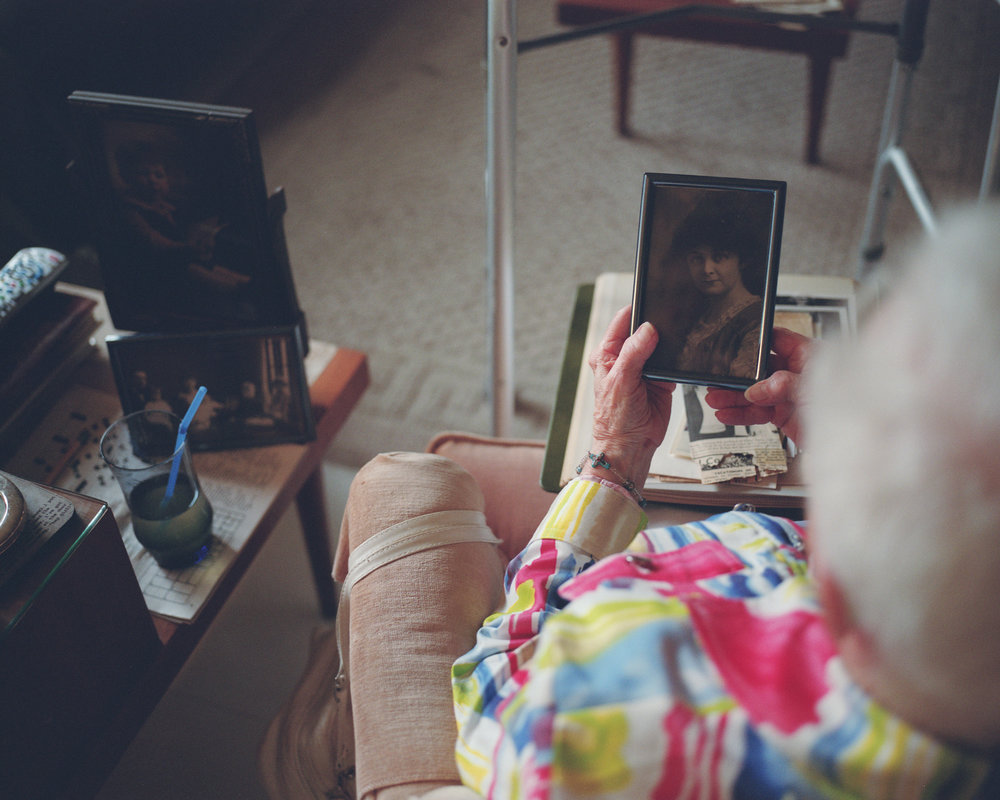 My grandmother holding a photograph of her mother