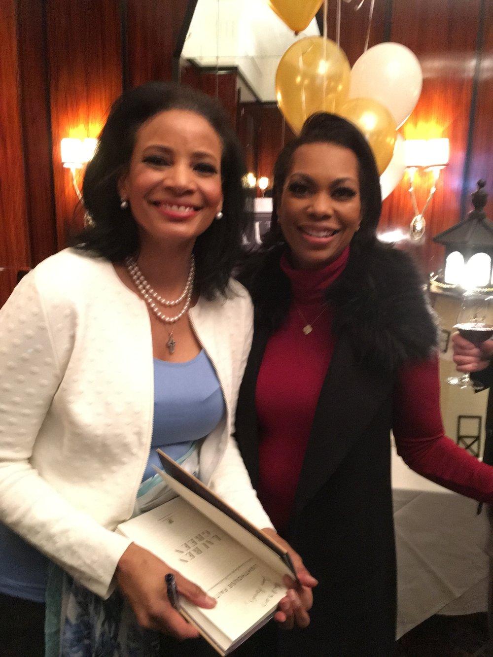 Lauren Green and Fox News anchor Harris Faulkner (right)