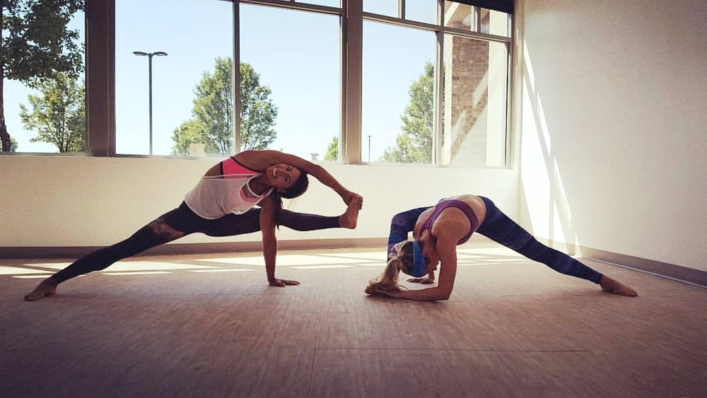 Preparing for fancy yoga poses with my friend, Yara at InBalance Yoga Studio. Orem, Utah 2015