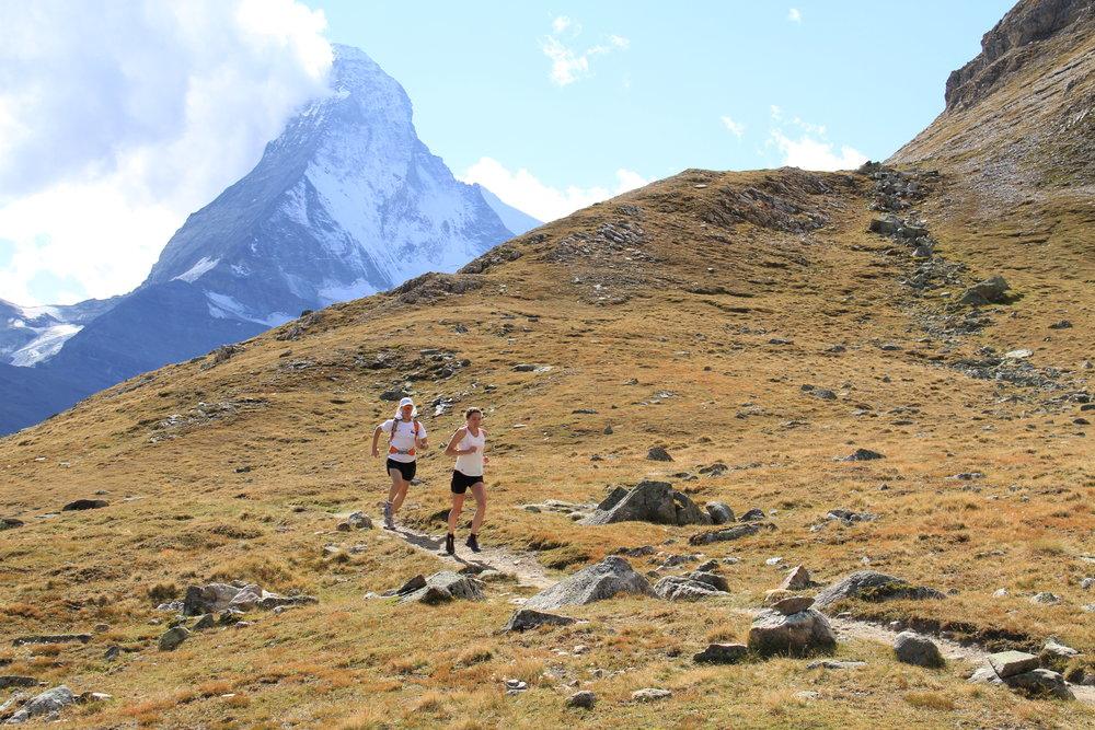 Emily and Matt trail running near the Matterhorn in Switzerland.