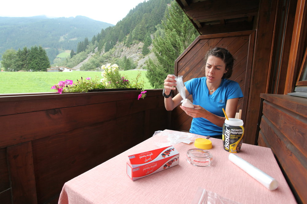 Emily dividing up the sports drink the day before we left.