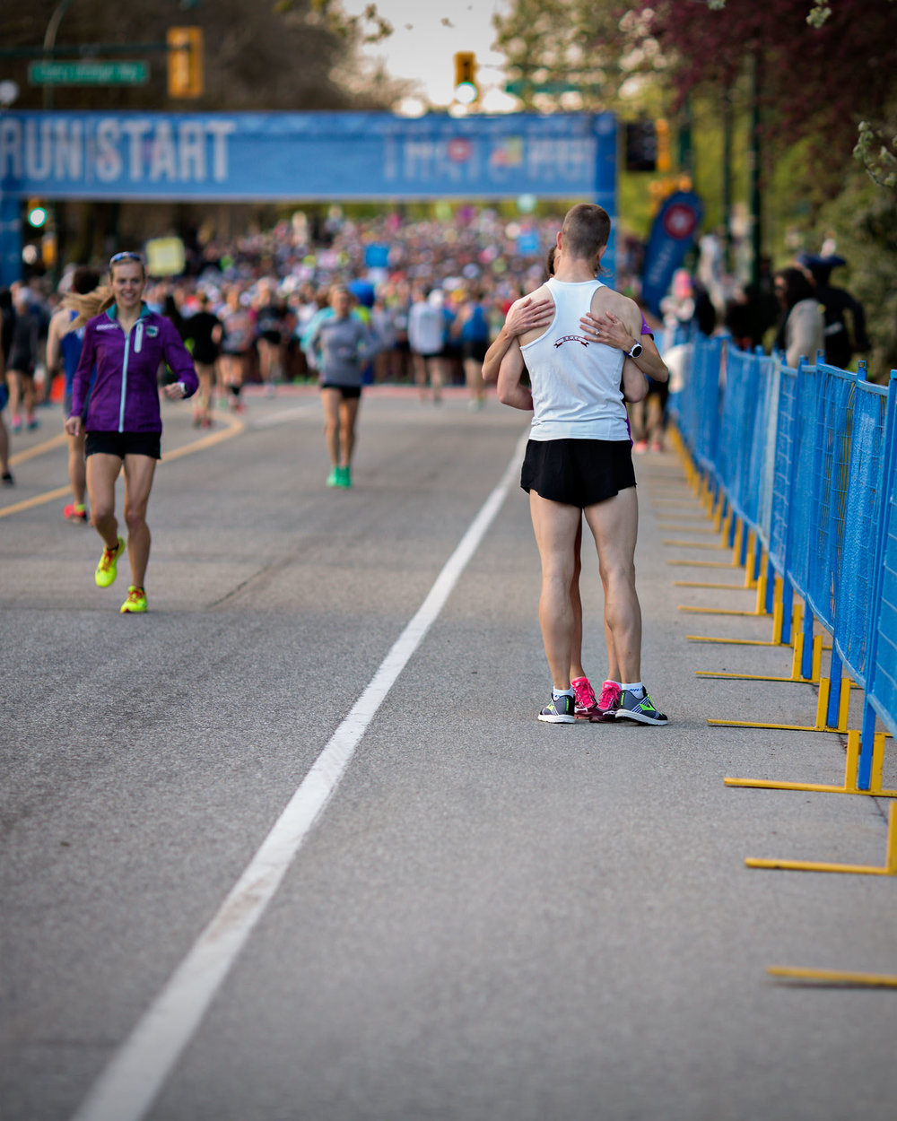 """There really is no feeling like the starting corrals of a race. I've spent my fair share of time in one as a photographer, but never as a runner. That will change at some point this year given my new found love for putting one foot in front of the other at a sub 4:30/KM pace...and getting faster with each training run. . I spot  @mattsetlack  warming up with only 8:07 left before this party at the  @bmovanmarathon  get's started. Matt is an elite runner. He is coming off a PB at the  @vancouversunrun  finishing outside the top 10. Just over 7 minutes before the gun, I see  @emilysetlack  coming over to Matt for a quick pre-race kiss before they both head back to opposite sides of the course to toe the start line. Emily coming off a PB and 4th female finish at the same  @vancouversunrun , they are both poised to have great races. And do they ever. The couple absolutely crushes their half marathon PB's by 2:15 and 2:00 with Emily finishing 2nd for females, and Matt 6th overall."" - Jody Bailey  Photo by: Jody Bailey (@run_photographs, jodybailey.ca)"