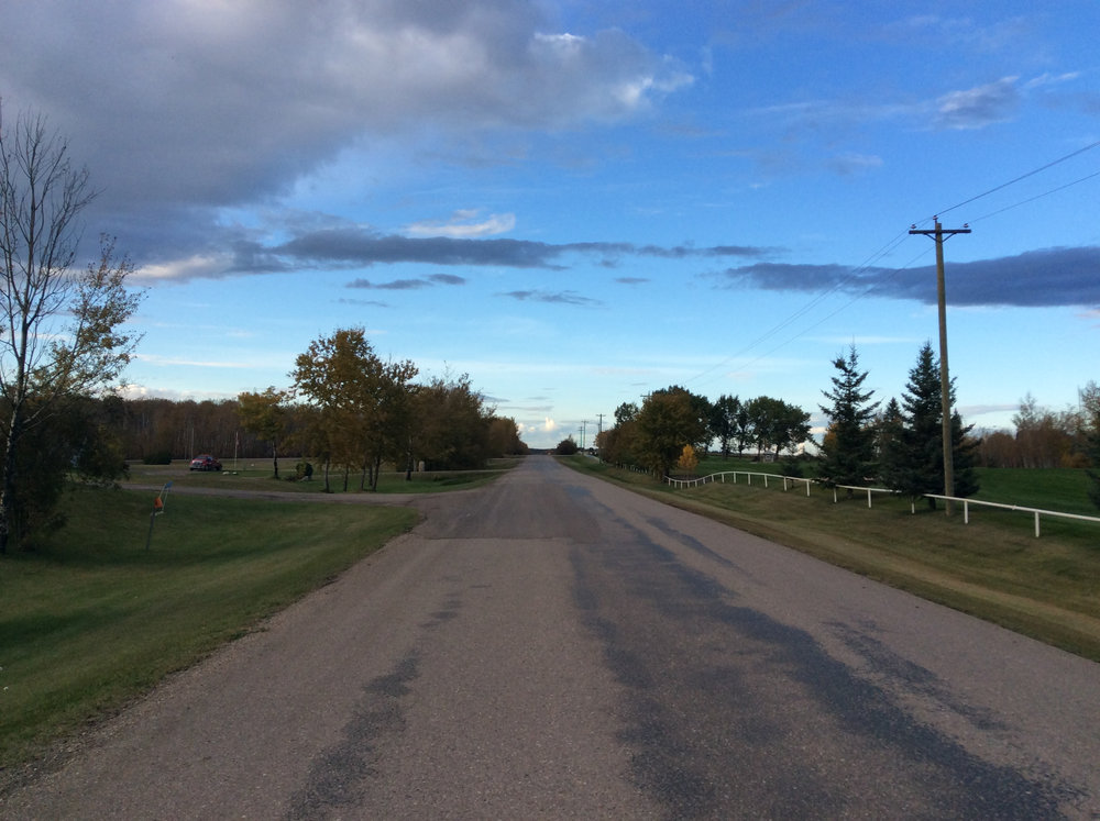 Looking north on Range Rd 420A near the Grand Centre Golf Course