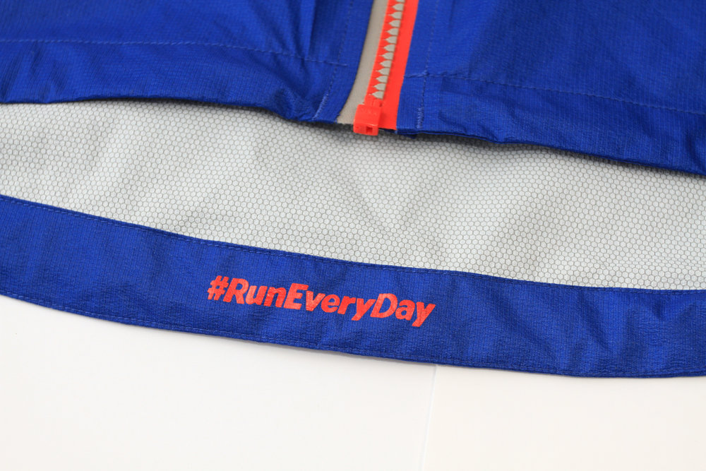 #RunEveryDay print on inside of center back of jacket