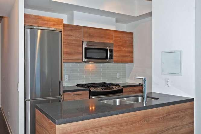 1201 Dundas Street E Unit 501-small-012-5-KitchenBreakfast Bar-666x444-72dpi.jpg
