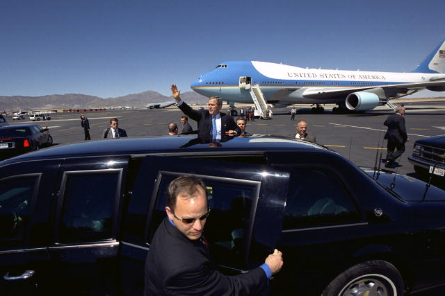 Secret Service Special Agents and Special Officers (foreground) protecting the President of the United States,George W. Bushin 2007.