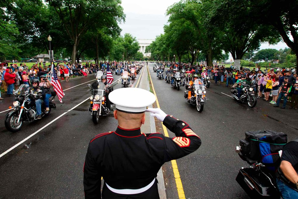 Chambers salutes as participants in the Rolling Thunder annual motorcycle rally ride in Washington DC. Photo:Jose Luis Magana/AFP/Getty Images