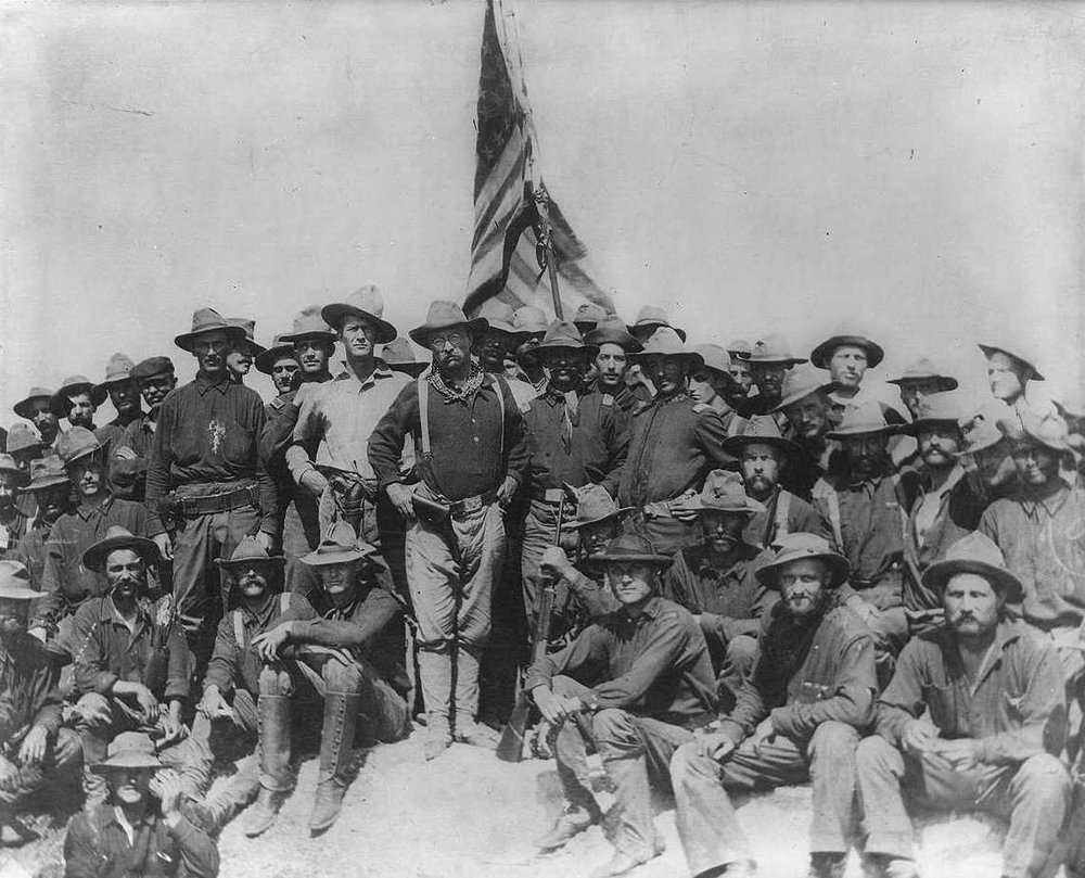"Col Theodore Roosevelt stands triumphant on San Juan Hill, Cuba after his ""Rough Riders"" captured this hill and its sister Kettle Hill during the Spanish American War. Theodore Roosevelt Association and Library of Congress as well as Public Domain"