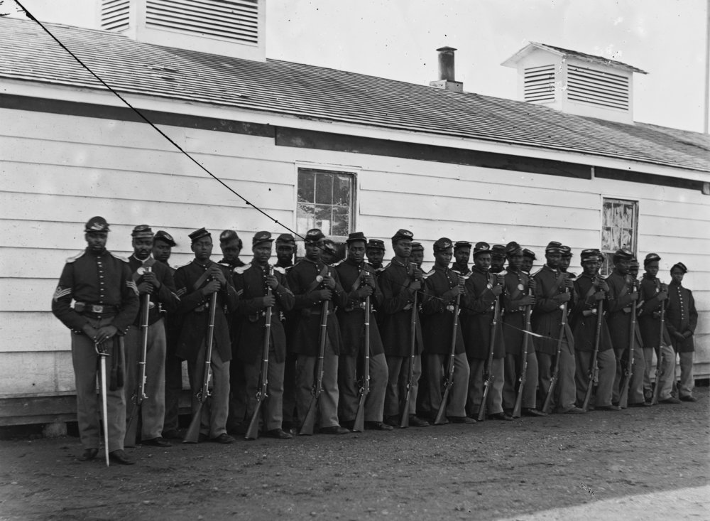 The men in this picture are from Company E, 4th United States Colored Infantry. Picture taken circa 1864