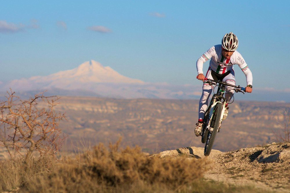 Sina racing in Turkey, Erciyes Peak in the background. Copyright Seb Rogers - https://www.cranked.cc/