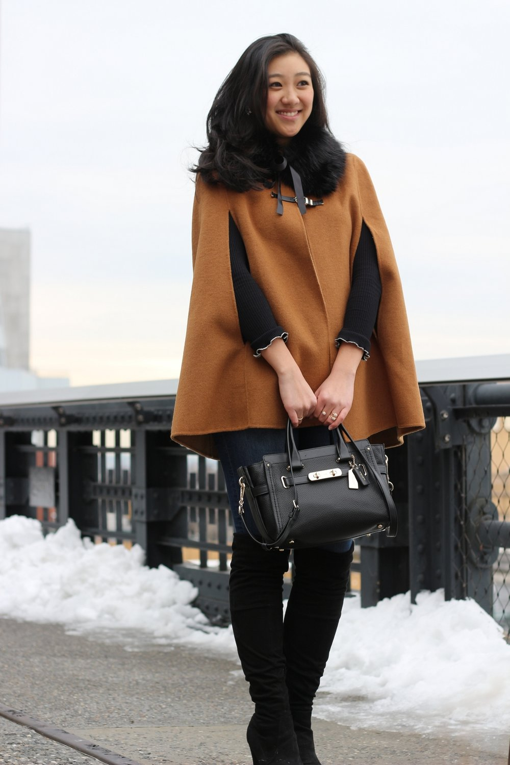 Bag:  Coach Swagger  | Cape: sold out but similar  here  and  here  | Boots:  Stuart Weitzman  | Jeans:  H&M