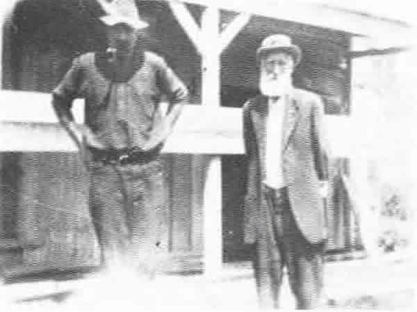 Early Settlers - Mr C. Kensington. One of the earliest settlers he helped Mr Goldsmith survey the district and with his two brothers, opened the first timber mill at Oropi in 1894. Pictured outside his barn with Mr J. B. Rogers