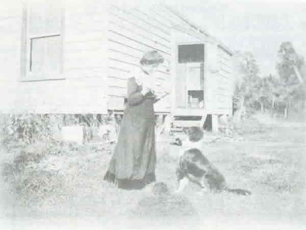 Early Settlers - Picture taken in the early 1900's of Mrs Thistlethwaite at her back door.