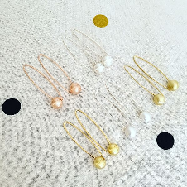 Handcrafted Long ball earrings in Sterling Silver, Rose Gold and Yellow Gold. Sterling Silver $75. Gold $85.