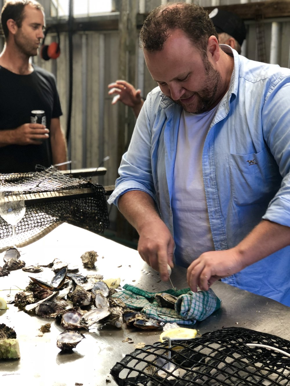 CHEF BEN TURNER SHUCKING FRESH TASSIE OYSTERS TO KICK OFF THE TOUR.