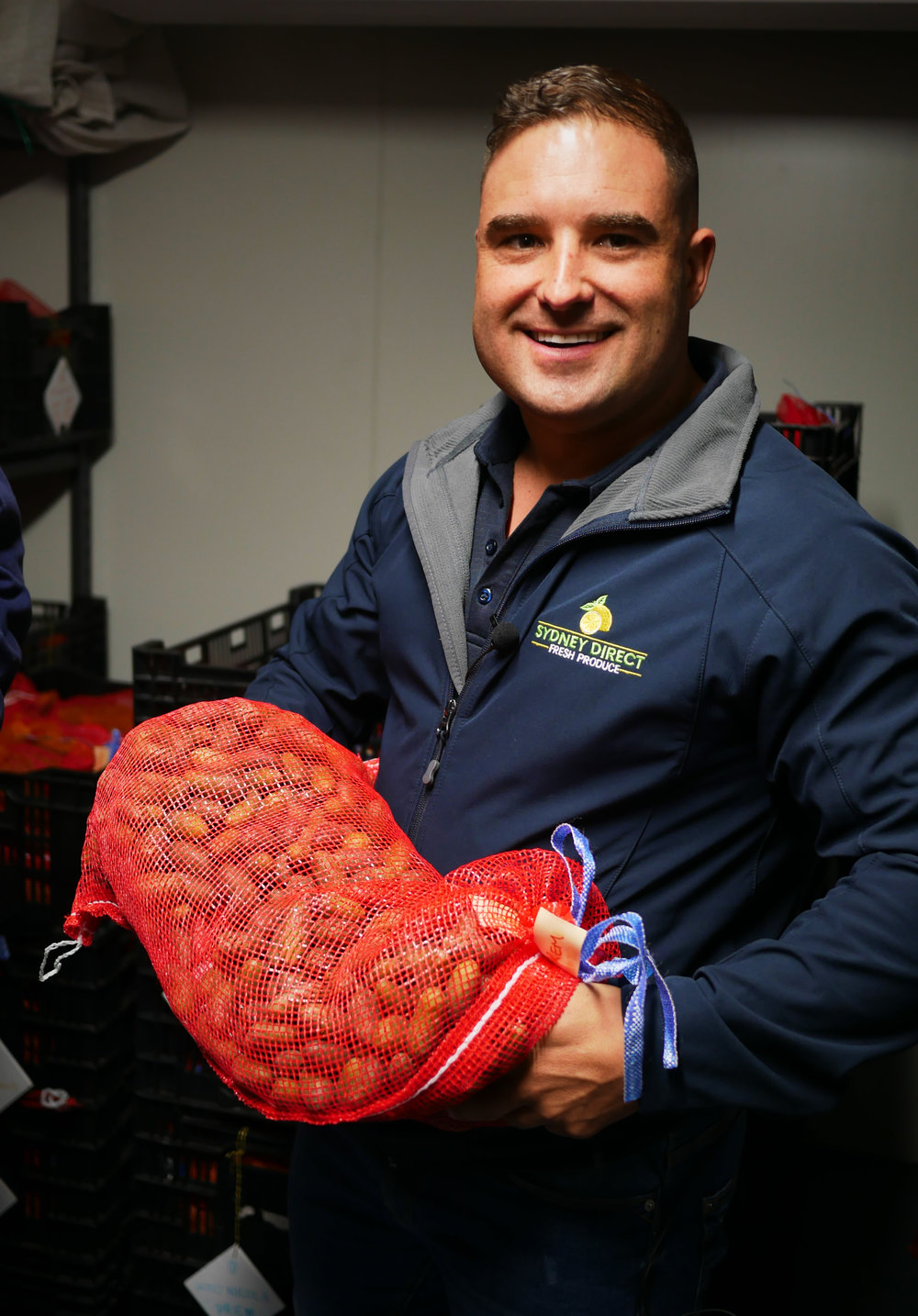 SDFP OWNER LUKE KOHLER HOLDING A PURE BREED POTATO