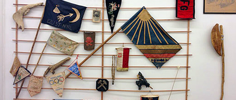 The Totem Wall of Pipecland, displaying the National and other flags, trophies and weapons amongst others